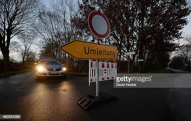 A police car stands at a police road block to a turkey farm where authorities discovered the H5N8 bird flu recently on December 16 2014 in Barssel...