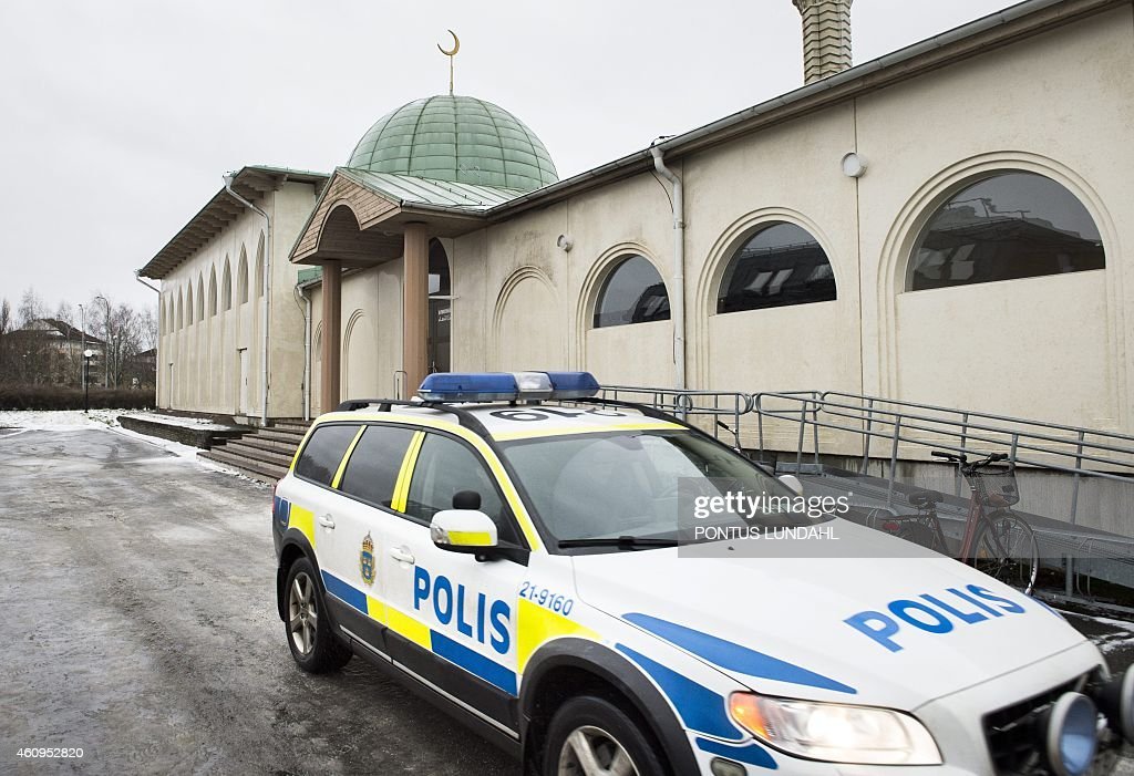 Police car stands in front of a mosque in Uppsala Sweden after a burntout molotov coctail was found early on January1 2015 Swedish police were...