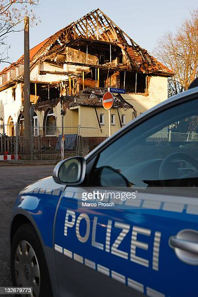 A police car stands in front of the burntout remains of the apartment that was once the residence of NSU murder trio Uwe Mundlos Uwe Boehnhardt and...