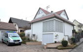 A police car stands in front of the house where 17yearold Tim Kretschmer lived with his parents in Leutenbach southern Germany on March 12 one day...