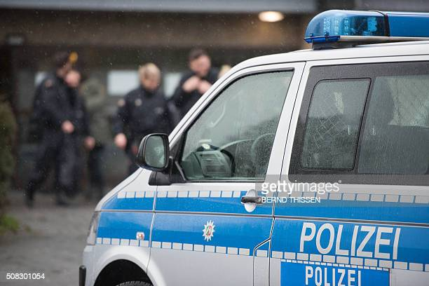 A police car stands outside a refugee shelter on February 4 2016 in Attendorn after a raid during which a suspect was arrested German police arrested...