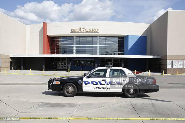 A police car stands outside The Grand Theatre on July 24 2015 in Lafayette Louisiana following the previous night's deadly shooting A 'drifter' with...