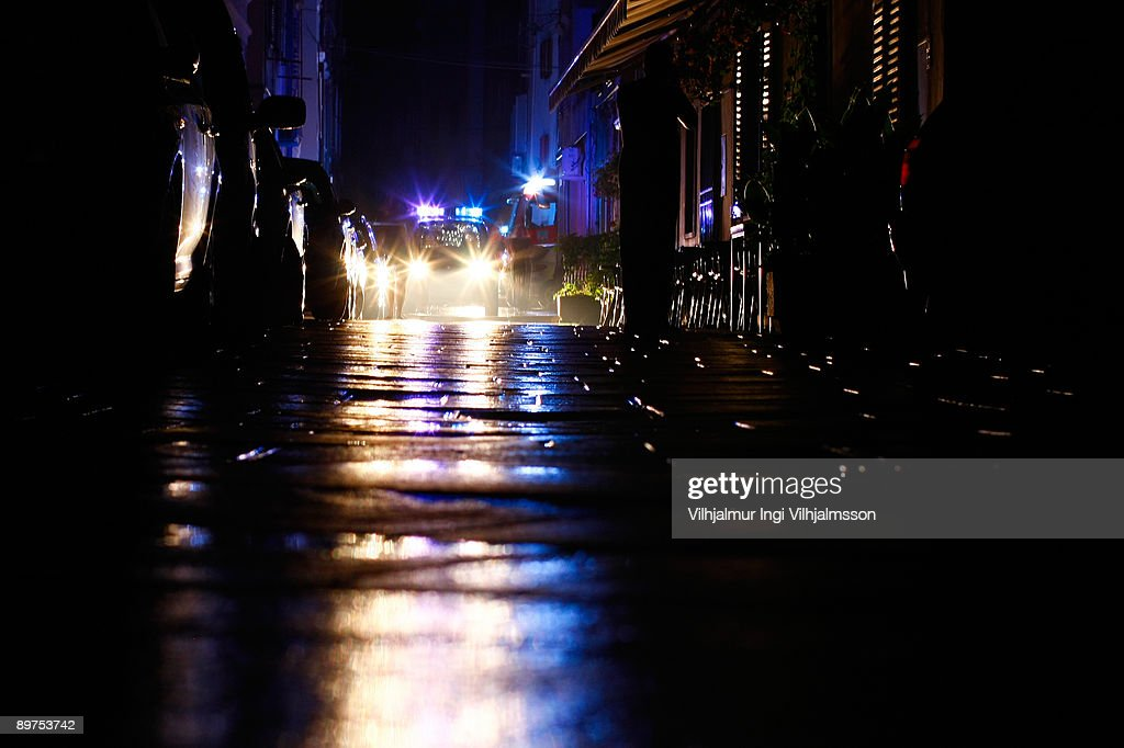 Police car with flashing lights at night : Stock Photo