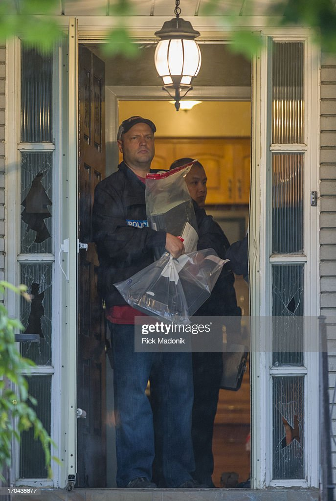 Police carry bags of goods seized from the house of Muhammed Khattak. Guns and Gang task force raid a number of places in the city. Much of the activity was focused on buildings on Dixon Road. One of the places also investigated was the home of Muhammed Khattak, the third person seen in the photograph with Mayor Rob Ford outside of 15 Windsor Road. Police launched a massive predawn raid on June 13, 2013, targeting guns and drugs. The focus is on the Toronto neighbourhood thats ground zero for the Mayor Rob Ford crack video scandal.