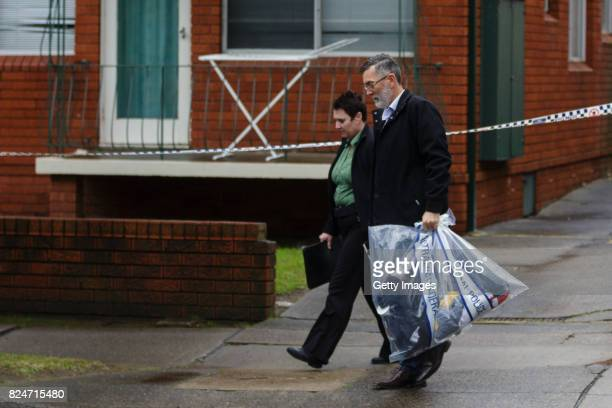 Police carry items from the scene of a terror raid in Sproule St Lakemba on July 30 2017 in Sydney Australia Counter terrorism police raided four...