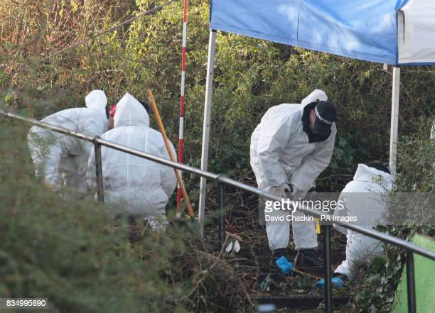 Police carry out a search of undergrowth in the Granton area of Edinburgh after the human remains were found there and is thought to belong to...