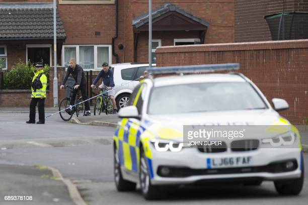 Police carry out an operation in a street in the Moss Side area of Manchester on May 28 2017 A British minister said Sunday members of suicide bomber...