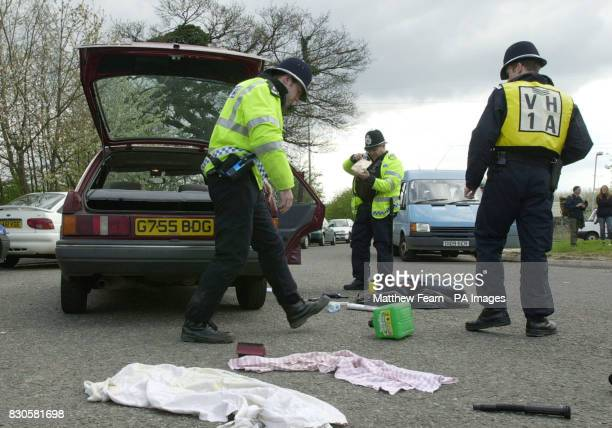 Police carry out searches as protesters from SHAC gather for a rally against Huntingdon Life Sciences at South Mimms service station on the M25 ahead...
