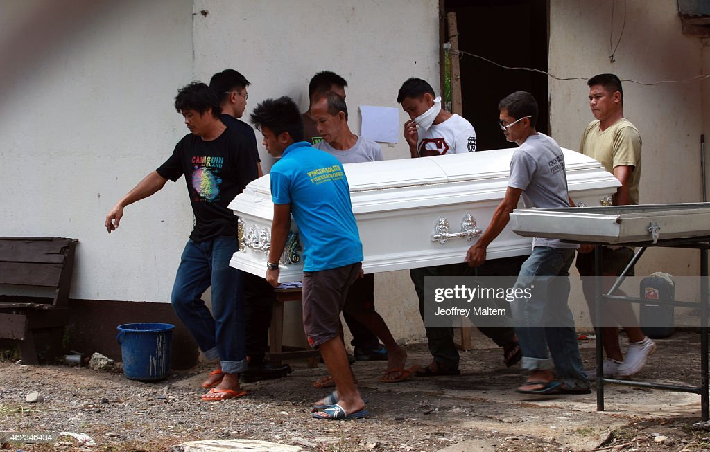 Police carry the coffin of their comrade on January 27, 2015 inside a military morgue in Datu Odin Sinsuat, Maguindanao Province, Philippines. Dozens of elite policemen were killed after a clash with a Muslim rebel group. Lawmen were trying to serve arrest warrants on January 25, 2015 for criminals led by Malaysian bomb maker Zulkifli bin Hir, known in military and police officials as Marwan, when the group clashed with the guerillas under Commander Guiawan of Bangsamoro Islamic Freedom Fighters, a breakaway group of the Moro Islamic Liberation, the countrys largest rebel group engaged in peace talks with Manila. The death toll of government fatalities in the fierce firefight reached fifty.