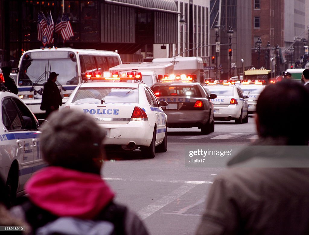 Police Cars and Bystanders in New York City : Stock Photo