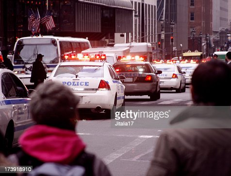 Police Cars and Bystanders in New York City