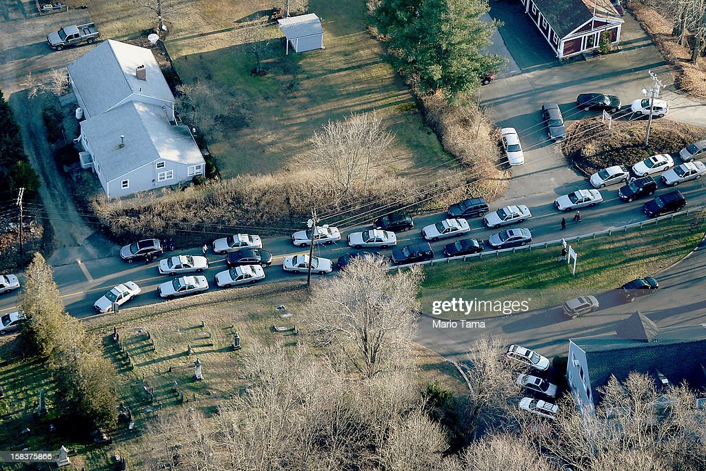 Police cars and other vehicles fill a road near the scene of a mass school shooting at Sandy Hook Elementary School on December 14, 2012 in Newtown, Connecticut. There are 27 dead, 20 of them children, after Adam Lanza reportedly opened fire in one of the largest school massacres in U.S. history. Lanza is dead at the scene and his mother, a teacher at the school, is also dead.