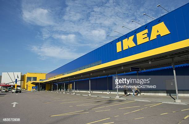 Police cars are parked outside IKEA store in the city of Vaesteraas about 100 km west of Stockholm on August 10 2015 Two people were stabbed to death...