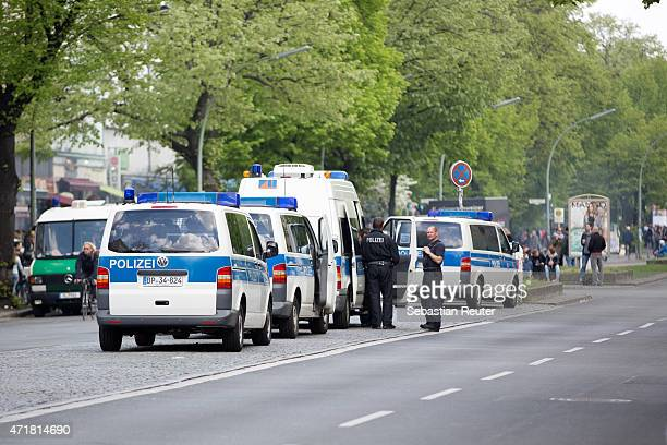 Police cars are seen near MyFest in BerlinKreuzberg on May 1 2015 in Berlin Germany May Day or International Workers' Day was established as a public...
