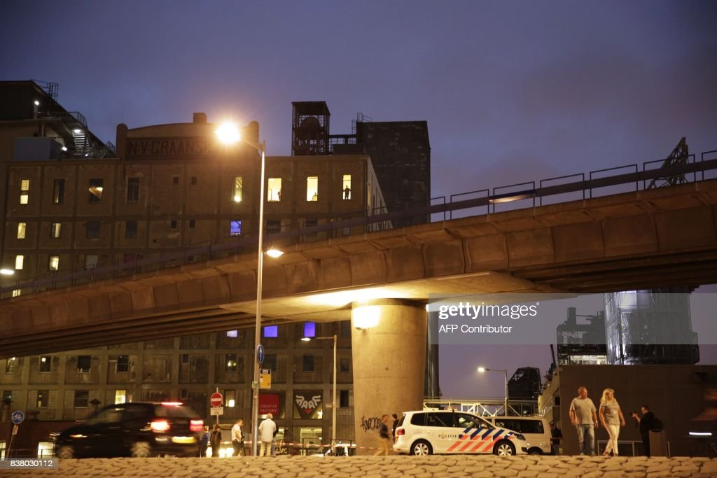 Police cars are seen near the concert venue Maassilo after a rock concert was cancelled due to a terror threat, in Rotterdam, The Netherlands, on August 23, 2017. A rock concert in Rotterdam was cancelled on August 23 due to a terror threat involving a Spanish van found with gas bottles inside, the local mayor said. Earlier the Maassilo venue announced that 'due to a terrorist threat, the Allah-Las concert will not take place this evening, on police orders'. Rotterdam police confirmed the decision was taken due to a 'possible terrorist threat' and that the van's driver had been arrested. / AFP PHOTO / ANP / Arie Kievit / Netherlands OUT