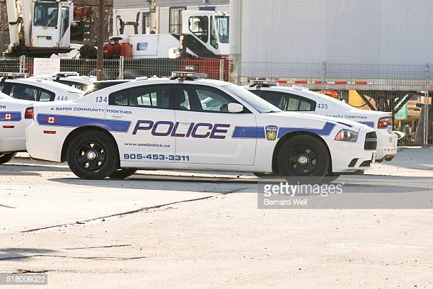 TORONTO ON MARCH 29 Police cars at Peel 11 division For feature on The Sunshine list for 2015 which reveals that more than 75 per cent of Peel...