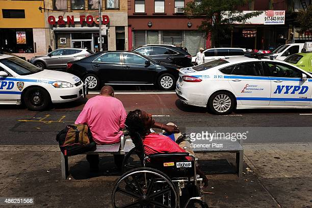 Police cars patrol an area which has witnessed an explosion in the use of K2 or 'Spice' a synthetic marijuana drug in East Harlem on September 02...