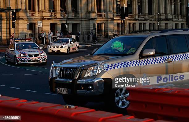 Police cars patrol the CBD on November 14 2014 in Brisbane Australia World economic leaders will travel to Brisbane for the G20 Leadership Summit...