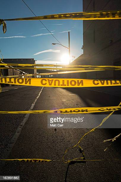 Police caution tape over road