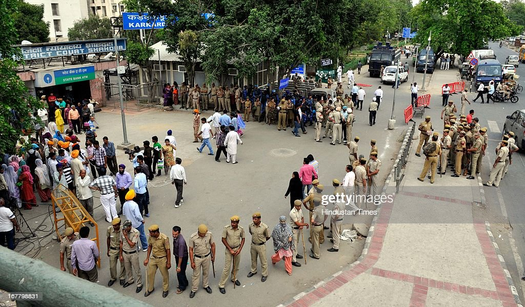 Police chain outside the court during the verdict in 1984 Sikh riots in Delhi Cantt after the court acquitted congress leader Sajjan Kumar lack of evidence at karkardhoma court on April 30, 2013 in New Delhi, India. Congress leader Sajjan Kumar has been acquitted by a special CBI court of all charges in one of three 1984 anti-Sikh riots cases against him. Kumar, a former Lok Sabha MP from Outer Delhi, still faces trial in another 1984 rioting case. In a third case, Delhi Police has filed a closure report, saying there was no evidence against Kumar to implicate him. The 1984 anti-Sikh riots broke out after the assassination of the then Prime Minister Indira Gandhi on October 31, 1984.