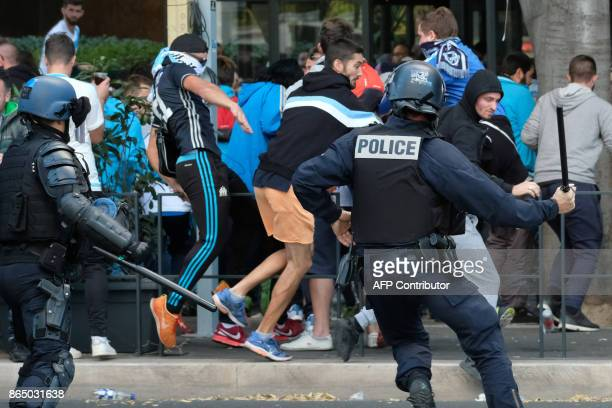 Police charge Olympique de Marseille supporters on October 22 near the Velodrome Stadium in Marseille southeastern France a few hours prior to kick...