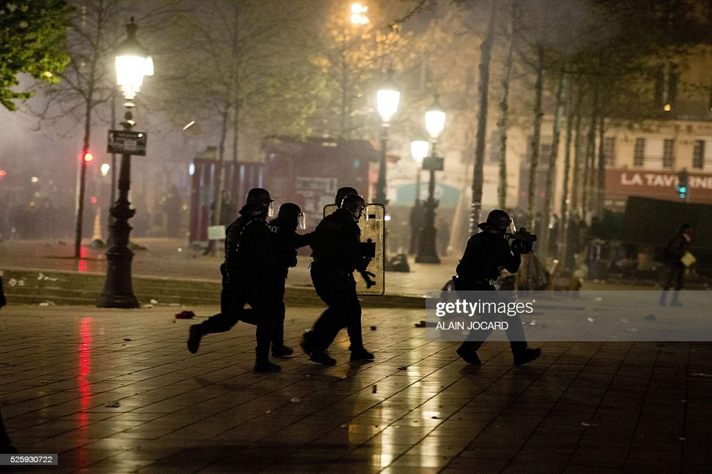 Police charge to clear the Place de la Republique in Paris during a protest by the Nuit Debout, or 'Up All Night' movement who have been rallying against the French government's proposed labour reforms on April 29, 2016. People were arrested and others detained during the overnight clashes in the French capital as the police dispersed the protesters whose movement began on March 31 in opposition to the government's proposed labour reforms. / AFP / ALAIN
