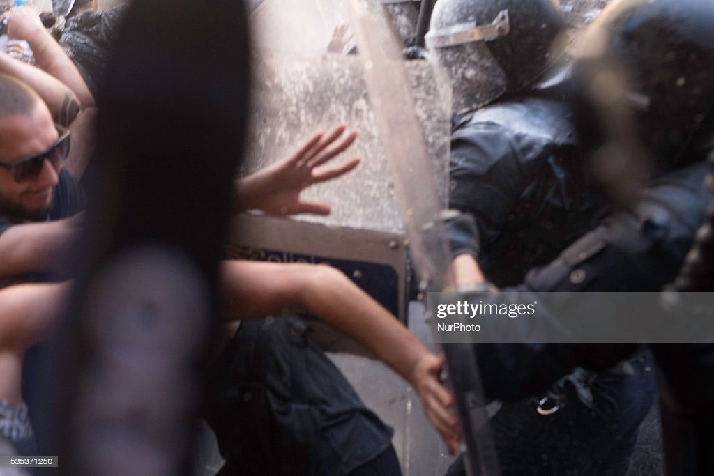 Police charging against demonstrators, during the riots for the squatted bank in Barcelona, on May 29 of 2016.