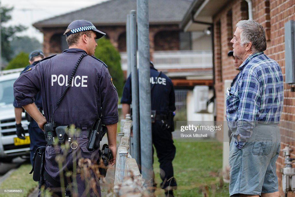 Police chat to residents in Salamader Pl, Greenacre not far from the street where the burnt-out remains of a vehicle used during a shooting at Bankstown Central Shopping Centre remains on April 29, 2016 in Sydney, Australia.