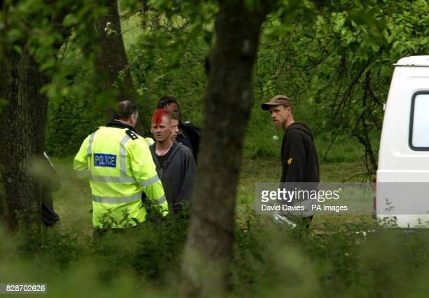 Police chat with revellers at the site of a rave outside Leominster in Herefordshire At least 20 organisers of the huge illegal bank holiday rave...