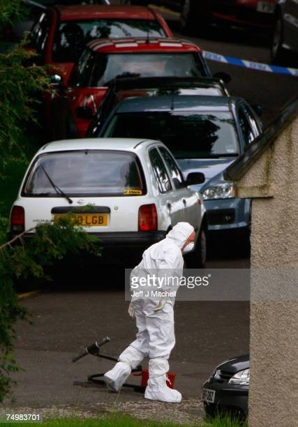 Police check a car after carrying out a controlled explosion at Royal Alexandra Hospital June 2 2007 in Glasgow Scotland Police have arrested a...