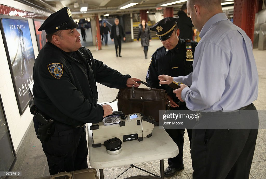 Police check a subway passenger's bag at Penn Station on April 16, 2013 in New York City. Police were out in force throughout New York, a day after explosions near the finish line of the Boston Marathon killed 3 people and wounded more than 170 others.