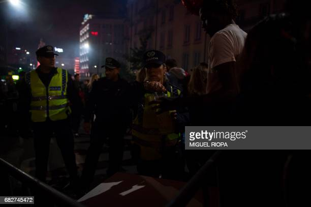 Police check Benfica's supporters as they arrive at Marques de Pombal square in downtown Lisbon on May 13 2017 to celebrate their team's victory in...