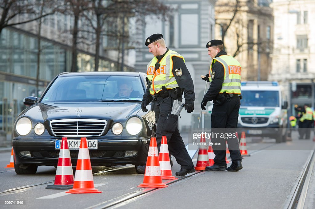 Police check cars entering the security zone around the hotel Bayerischer Hof ahead of the 2016 Munich Security Conference at the Bayerischer Hof hotel on February 12, 2016 in Munich, Germany. The annual event brings together government representatives and security experts from across the globe and this year the conflict in Syria will be the main issue under discussion.