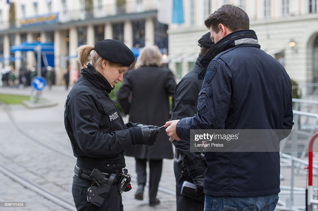 Police check people entering the security zone around the hotel Bayerischer Hof ahead of the 2016 Munich Security Conference at the Bayerischer Hof hotel on February 12, 2016 in Munich, Germany. The annual event brings together government representatives and security experts from across the globe and this year the conflict in Syria will be the main issue under discussion.