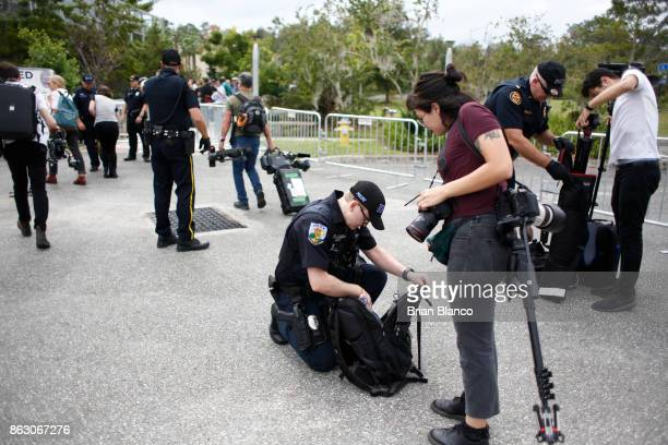 Police check the bags of journalists entering the site of a planned speech by white nationalist Richard Spencer who popularized the term 'altright'...