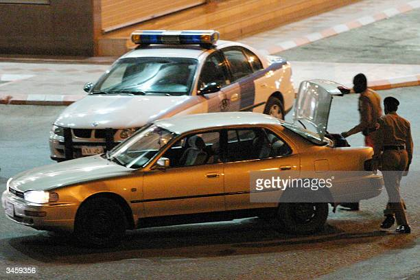 Police check the boot of a car a day following a car bomb in the capital Riyadh during a raid in the port city of Jeddah late 22 April 2004 Saudi...