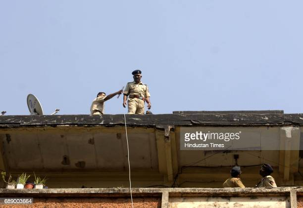 Police checking the spot on terrace of the Building No 13 Mahim Police Colony from where Vijay Murudkar Assistant Sub Inspector Bandra police Station...