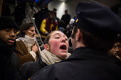Police clash with demonstraters protesting the Staten Island New York grand jury's decision not to indict a police officer involved in the chokehold...