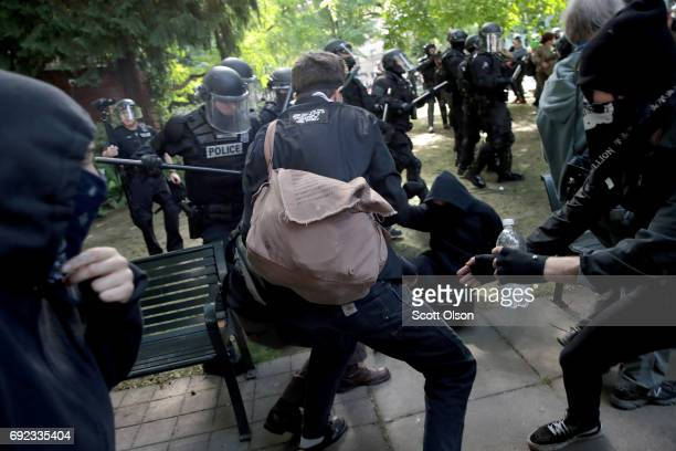 Police clash with demonstrators as they try to clear 'Antifa' members and antiTrump protesters from the area during a protest on June 4 2017 in...
