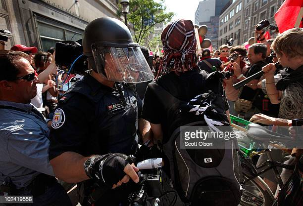Police clash with demonstrators protesting the G8/G20 summits June 25 2010 in Toronto Ontario Canada The protest was one of several planned in the...