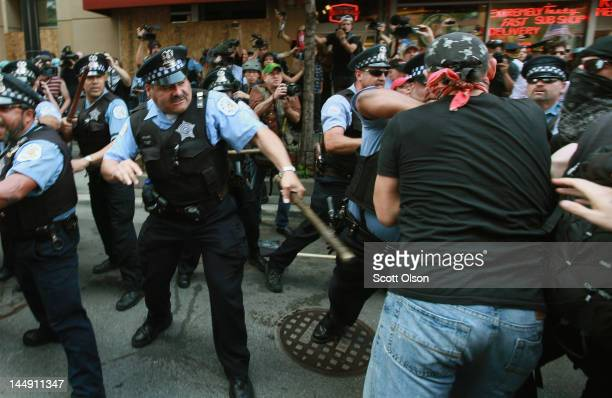 Police clash with demonstrators protesting the NATO Summit during a march through downtown streets on May 20 2012 in Chicago Illinois Today is the...