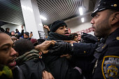 Police clash with demonstrators protesting the Staten Island New York grand jury's decision not to indict a police officer involved in the chokehold...