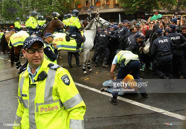 Police clash with 'Occupy Melbourne' protestors on October 21 2011 in Melbourne Australia Protesters and riot police clashed in Melbourne today after...