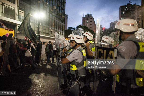 Police clash with protesters as they demonstrate in the streets against the expenditure which has exceeded $11 billion of the upcoming FIFA World Cup...