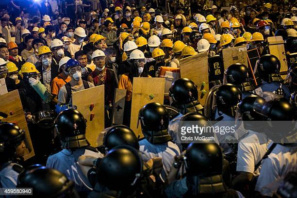 Police clash with protesters as they try to clear the streets after agents authorized by bailiff's removed barricades on Argyle Street in Mongkok...
