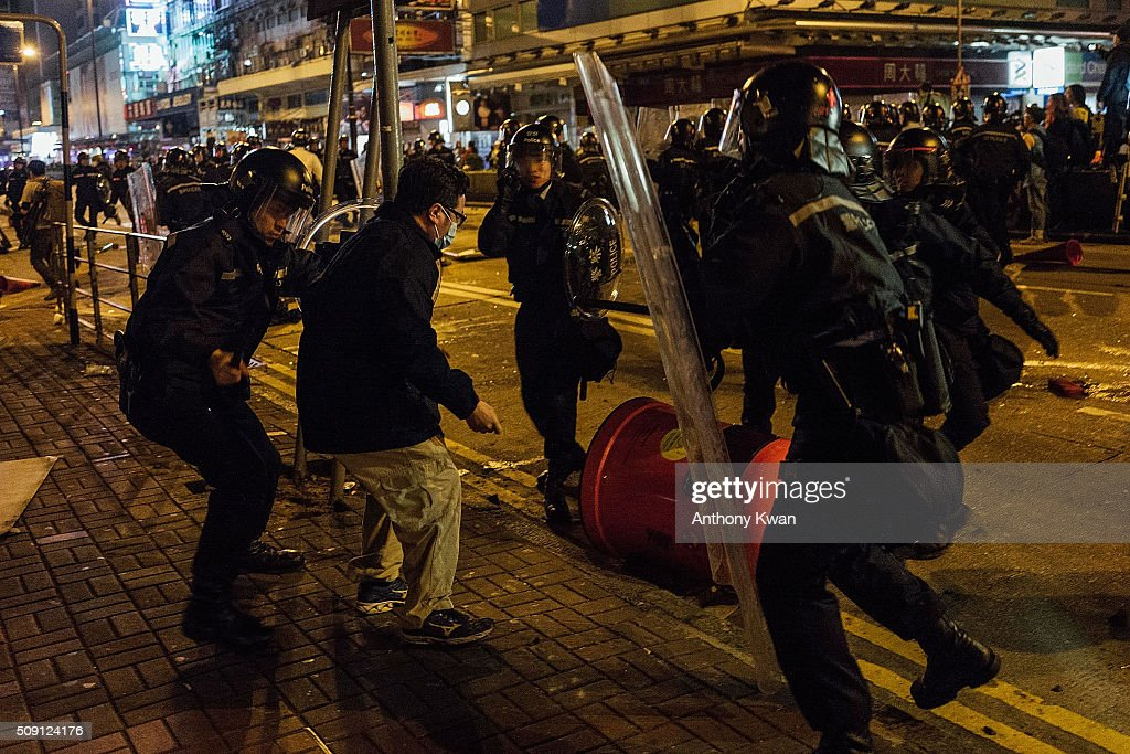 Police clash with protesters at Mongkok on February 9, 2016 in Hong Kong. More than 40 police officers and journalists have been injured after a riot with protesters on the first day of Chinese New Year celebrations.
