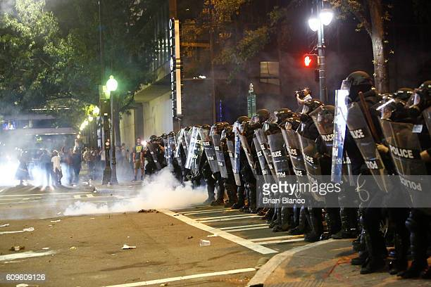 Police clash with protestors as residents and activists protest the death of Keith Scott September 21 2016 in Charlotte North Carolina Scott who was...