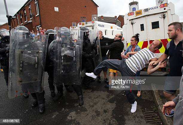 Police clash with Republicans in the Oldpark area of north Belfast northern Ireland on August 9 after police stopped an annual antiinternment parade...