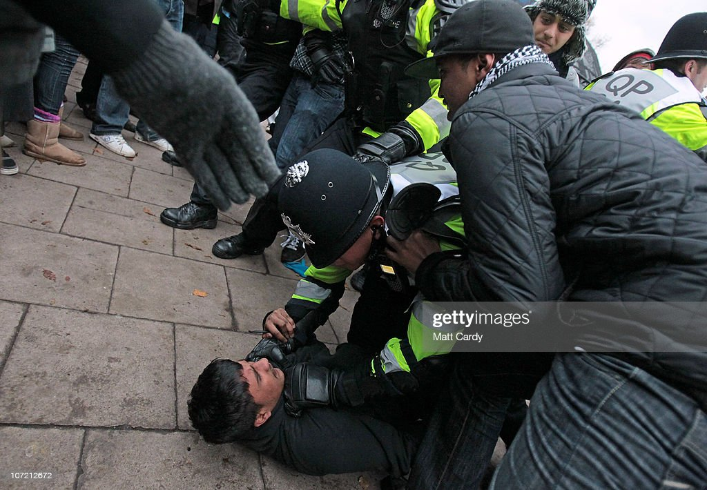 Police clash with students who are trying to occupy a Bristol University building as they take part in a protest over the Government's budget cuts and proposed rise in tuition fees on November 30, 2010 in Bristol, England. Hundreds of students demonstrated in the second major protest of its kind in Bristol in as many weeks
