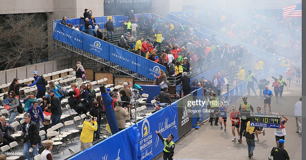 Police clear the bleachers after two explosions went off near the finish line of the 117th Boston Marathon on April 15, 2013.